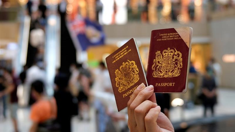UK details route to citizenship for HK people drawing China anger